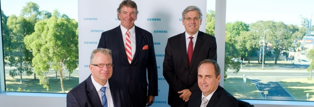 (Standing L to R) Lloyd Thomas, Chairman of APS Group, Jeff Connolly, CEO and Chairman of Siemens Pacific, (seated L to R) Michael Freyny, the head of Digital Factory and Process Industries at Siemens Australia and New Zealand and David Hegarty, Managing Director and CEO of APS Industrial.